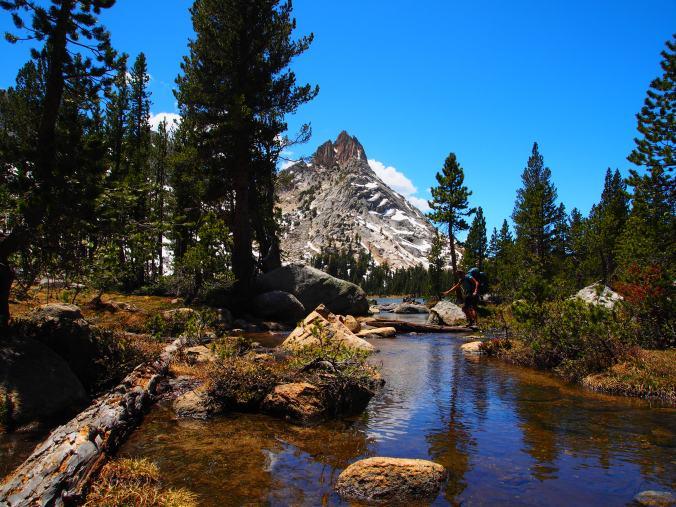 Stream hopping, Ragged Peak in the background