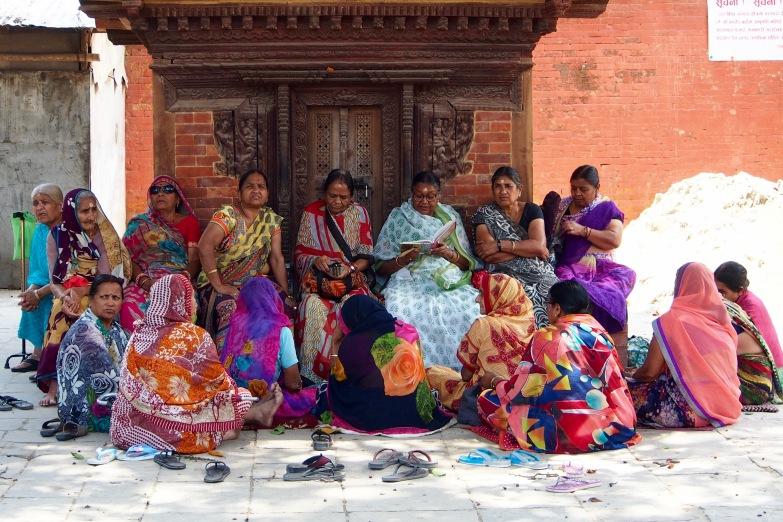 Local women gather near Durbar Square in Kathmandu