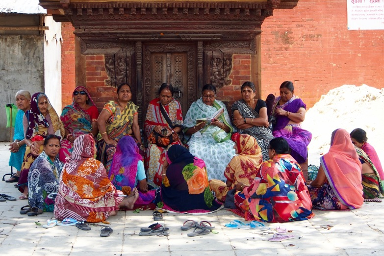 Local women gather near Durbar Square in Kathmandu