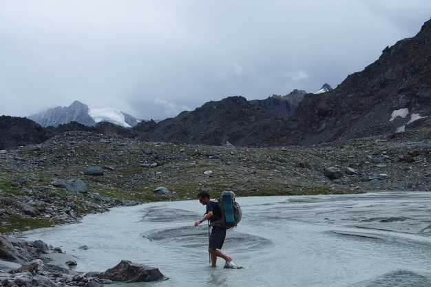 Icy glacial stream crossing