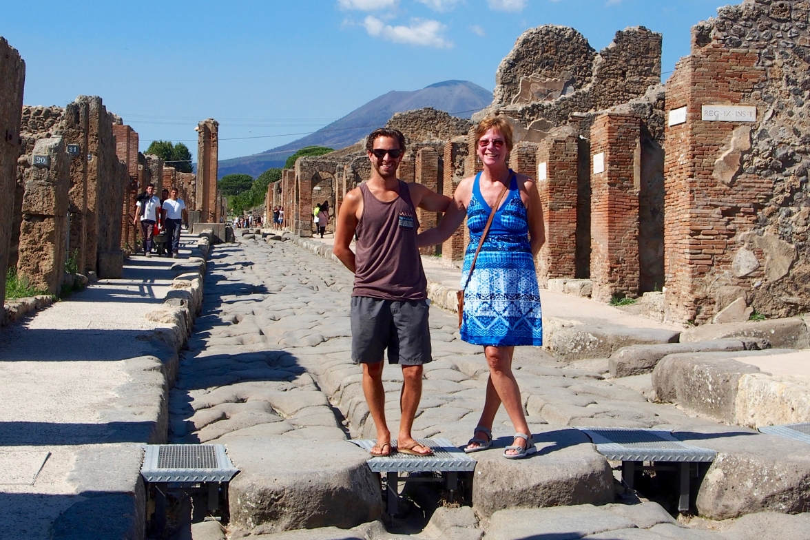 The walking the streets of Pompeii, Mount Vesuvius in the background